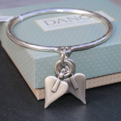 Danon Silver Hammered Bangle with double Danon Signature hearts in silver image copyright birdhouse jewellery