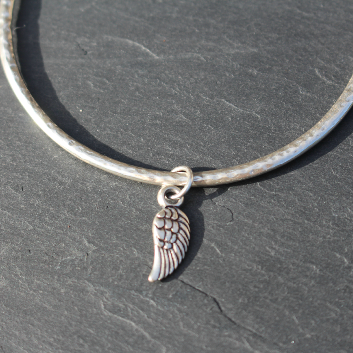Danon Jewellery Silver Bangle with Tiny Delicate silver mini micro angel wing charm available at Birdhouse Jewellery www.birdhousejewellery.com Copyright www.birdhousejewellery.com