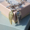 Danon T-Bar Chunky Silver Bracelet with Two Angel Wing Charms (one silver, one gold)